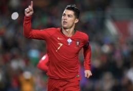 """Po """"hat-tricko"""" prieš Lietuvą – komandos draugų ir trenerio pagyros C. Ronaldo"""