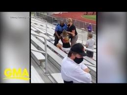 JAV areštuota kaukės stadione nedėvinti mergina